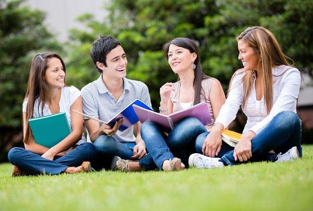 Students enjoying nature while studying.
